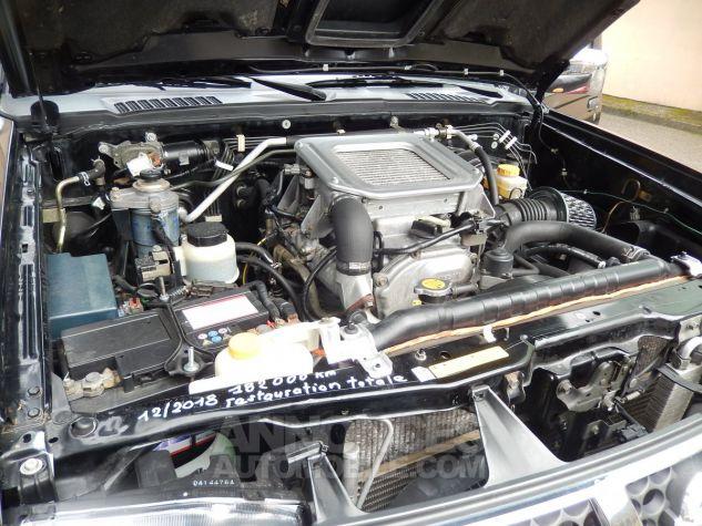 Nissan Pick Up Personnalisé base KingCab bicolore noir/orangé mét. Occasion - 7
