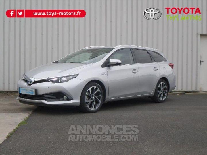 Toyota AURIS TOURING SPORTS HSD 136h Design Business GRIS Occasion - 1