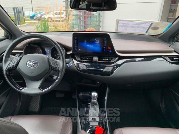 Toyota C-HR 122h Distinctive 2WD E-CVT ROUGE ALLURE Occasion - 7