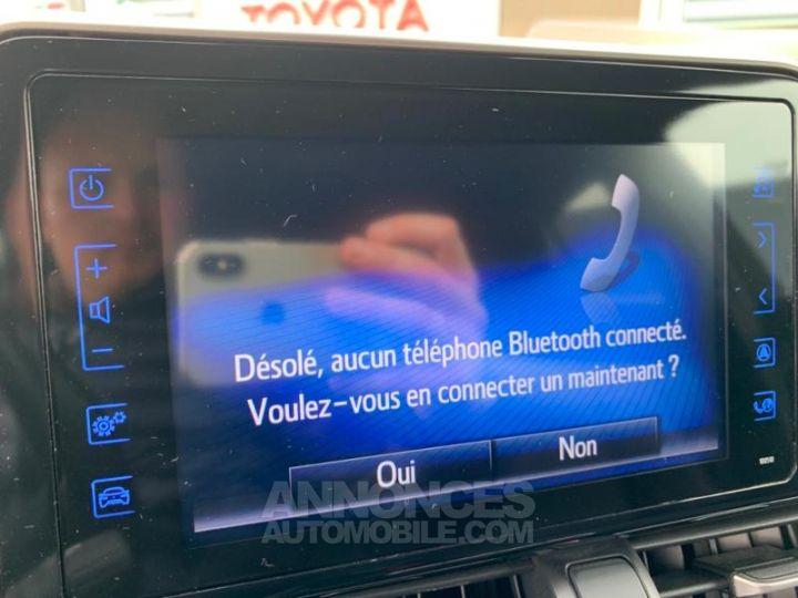 Toyota C-HR 122h Distinctive 2WD E-CVT ROUGE ALLURE Occasion - 11