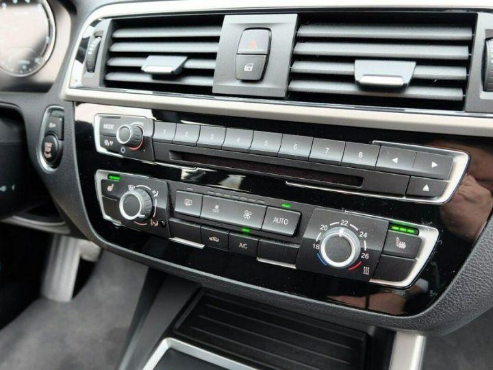 BMW Série 1 118i 1.5 136 sport (12/2017) noir métal - 17