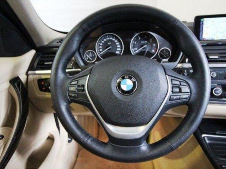 BMW Série 3 Touring 330 d Auto  xDrive 258 (01/2014) noir métal - 13