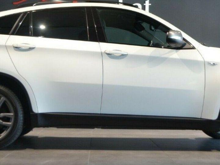 BMW X6 (2) M50DA 381 (07/2012) 5 places. BLANC ALPIN 3 - 4
