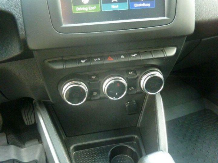 Dacia Duster 1.4 dci 110 Prestige , Automatique 04/2018 gris comète  métal - 12
