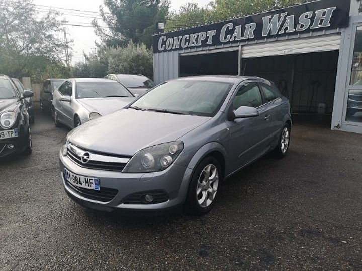 Opel Astra COUPE GRIS FONCE METAL Occasion - 1