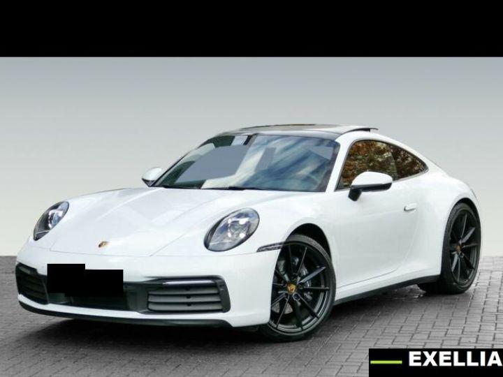Porsche 911 992 CARRERA 4  BLANC PEINTURE METALISE  Occasion - 1
